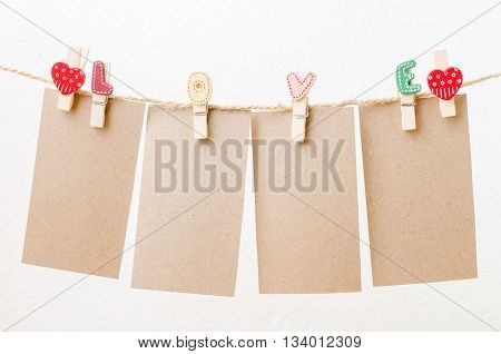 Blank Paper Hanging On Love Clothesline With White Background