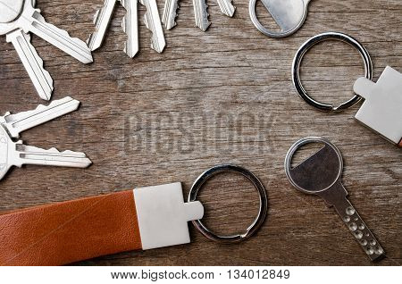 House Key On Wooden Background With Leather Key Chain On Wooden Background