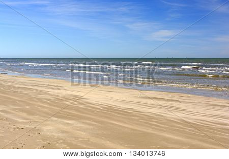 Waves and Sand on a Remote Beach on Padre Island National Seashore on the Gulf Coast of Texas