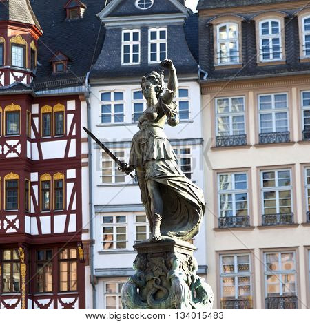 FRANKFURT, GERMANY - JUNE 3, 2014: Statue of Lady Justice in front of the Romer in Frankfurt - Germany