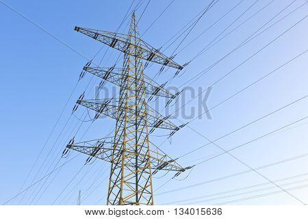 Electrical Pylon Under Blue Sky