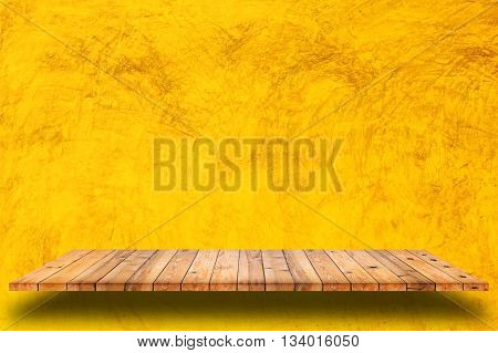Empty wooden shelves and yellow cement wall background. For display or montage your products.