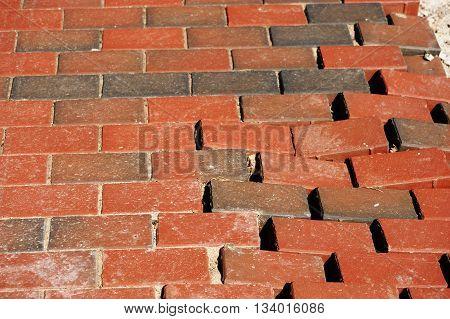 footpath red brick wall pavement sidewalk damaged