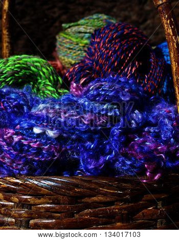 Colorful hand span yarn overflows from a basket.