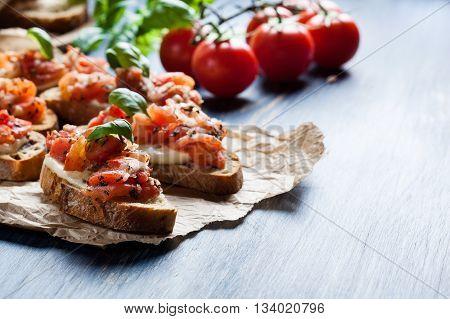 Italian Bruschetta With Roasted Tomatoes, Mozzarella Cheese And