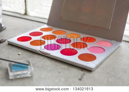 palette of makeup colors in different red colors
