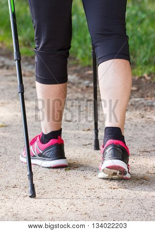 Legs Of Elderly Senior Woman Practicing Nordic Walking, Sporty Lifestyles In Old Age