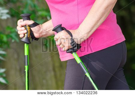 Hand Of Elderly Senior Woman With Nordic Walking Sticks, Sporty Lifestyles In Old Age