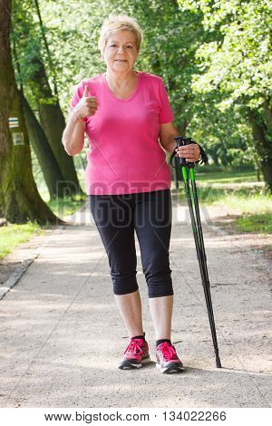 Elderly Senior Woman Practicing Nordic Walking And Showing Thumbs Up, Sporty Lifestyles