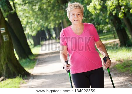 Elderly Senior Woman Practicing Nordic Walking, Sporty Lifestyles In Old Age