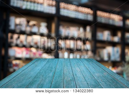 Perspective blue wooden with coffee shop blurred background with bokeh, stock photo