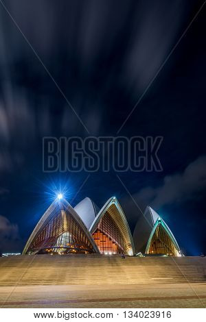 SYDNEY, AUSTRALIA - APRIL 19: Sydney Opera house with staircase at night with moon long exposure. Opera is one of most recognizable building of 20th century. April 2016