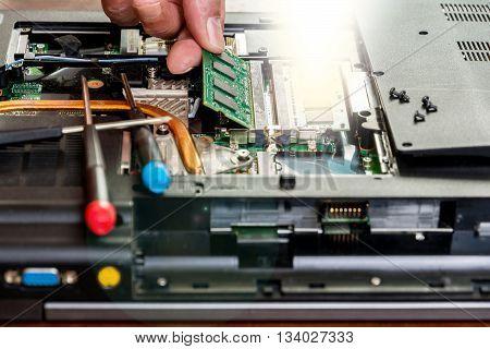 Man fixing damaged memory computer or laptop.