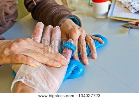 Hand Physiotherapy To Recover A  Finger