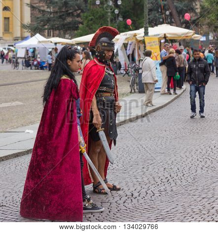 Verona Italy September 27 2015: Man and woman dressed as legionnaires expect wishing to be photographed with them in Piazza Bra in Verona Italy