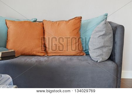 Modern Living Room Interior With Grey Velvet Sofa And Colorful Pillows At Home