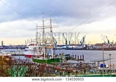 HAMBURG, GERMANY - JUNE 3, 2011: old sailor on pier of Landungsbruecken in Hamburg