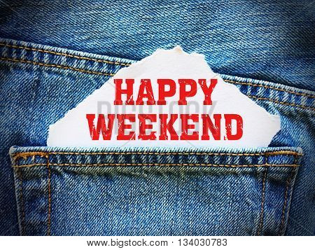 Happy Weekend on white paper in the pocket of blue denim jeans