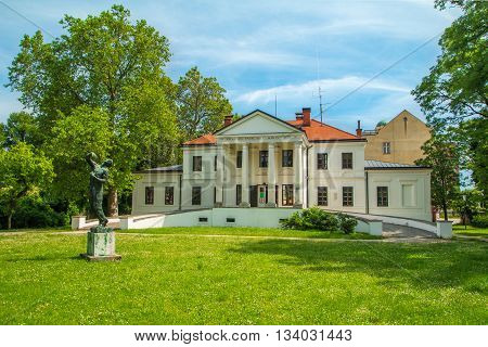 """Park and palace of observatory in Varazdin, Croatia. Latin text on building means: """"Not to live for themselves only, but to serve others."""
