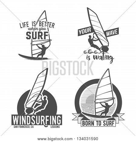 Set of windsurfing retrolabels, badges and logotypes. Surfer vector set. Vintage surf design elements.