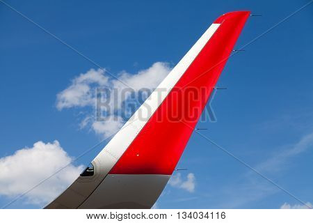 wing of an airplane with blue sky in the background