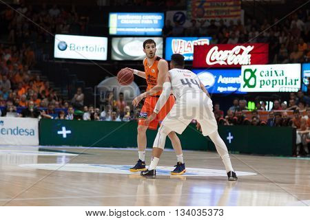 VALENCIA, SPAIN - JUNE 9th: Vives with ball and Taylor during 4th playoff match between Valencia Basket and Real Madrid at Fonteta Stadium on June 9, 2016 in Valencia, Spain