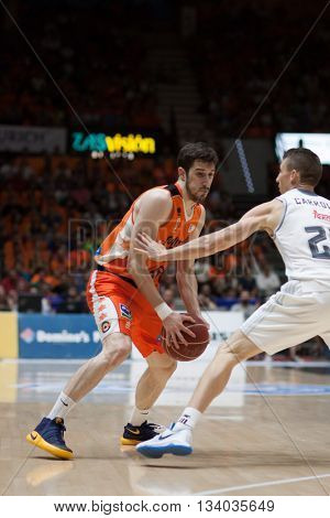VALENCIA, SPAIN - JUNE 9th: Vives with ball and Carroll during 4th playoff match between Valencia Basket and Real Madrid at Fonteta Stadium on June 9, 2016 in Valencia, Spain