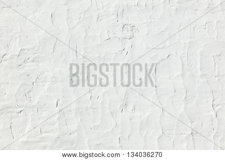 Grunge texture of white cement wall  gives a harmonic background