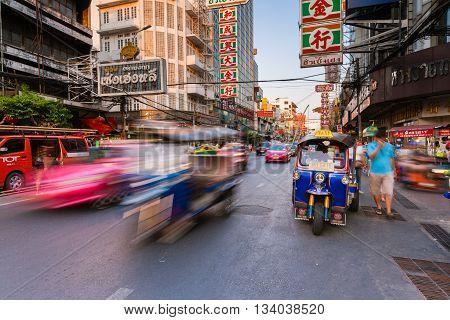 BANGKOK, THAILAND - APRIL 24: Tuk-tuk taxi parked near street market in Chinatown on April 24 2016 in Bangkok Thailand.