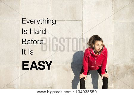 Woman Resting After Running. Motivational Phrase
