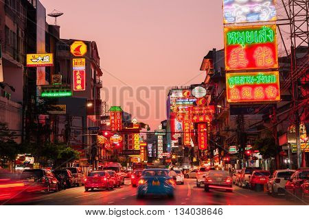 BANGKOK THAILAND - APRIL 24: Sunset view of illuminated Yarowat road in Chinatown on April 24 2016 in Bangkok Thailand.