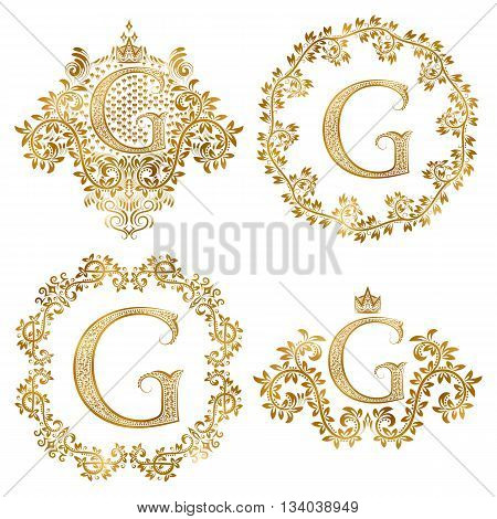 Golden letter G vintage monograms set. Heraldic monogram in coats of arms form letter G in floral round frame letter G in wreath heraldic monogram in floral decoration with crown.