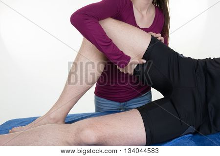 Real Professional Female Masseur Giving Therapeutic Massage To Man's Legs
