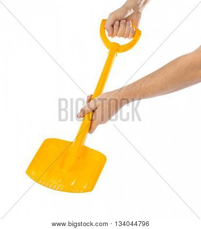 Hands with shovel isolated on white background