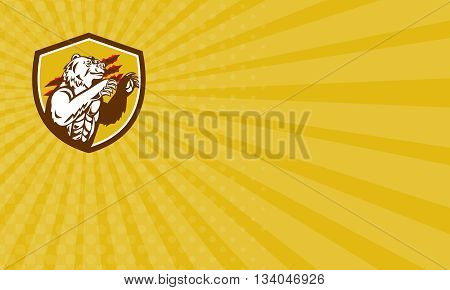 Business card showing illustration of a smirking California grizzly North American brown bear his paw raised viewed from the side with claw marks in the background done in retro style set inside crest shield.