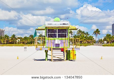 MIAMI, USA - JUNE 3, 2012: wooden colorful beach watch hut at the beautiful white beach