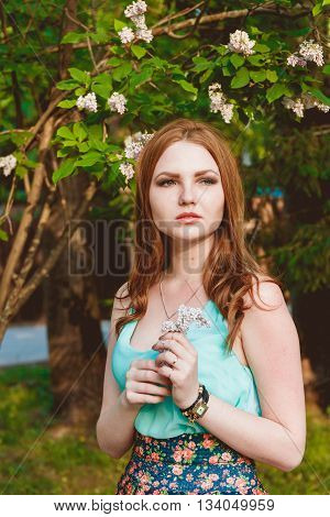 Beauty Girl Outdoors Enjoying Nature. Beautiful Teenage Model Girl with Long Hair, Free Happy Woman. Toned in warm colors. Beauty Concept