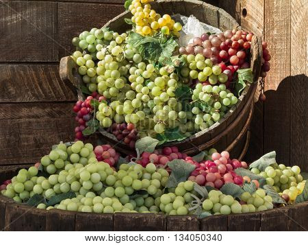 Bunch of Colorful Grapes in Wodden Basket on Shelf For Sale