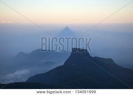 A triangular shadow of Adam's peak in the early morning. Sri Lanka