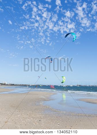 Melbourne - March 3 2016: many people are engaged in kite surfing in the Bay Port Phillip in Victoria harbor with yachts and March 3 2016 Melbourne Australia
