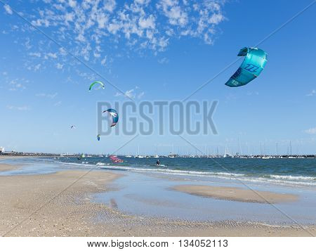Melbourne - March 3 2016: people engage in kite Bay Port Phillip in Victoria harbor with yachts and March 3 2016 Melbourne Australia