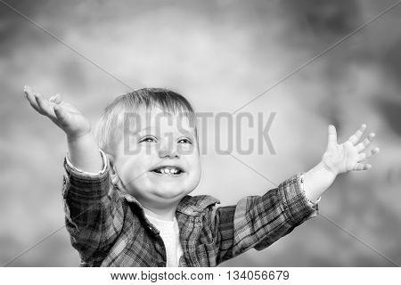 Adorable smiling happy little boy. Monochrome photo