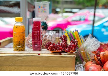 Pomegranate and passion fruit juice at a street vendor's stall Bangkok Thailand.
