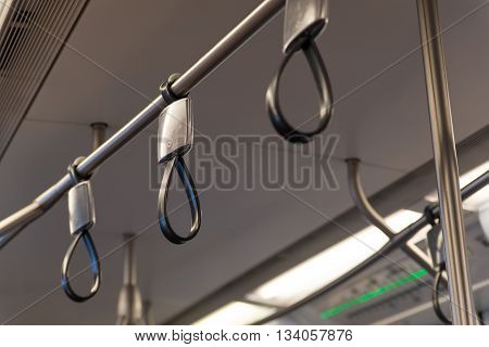 Rubber hand rails on a public transit train Bangkok Thailand.