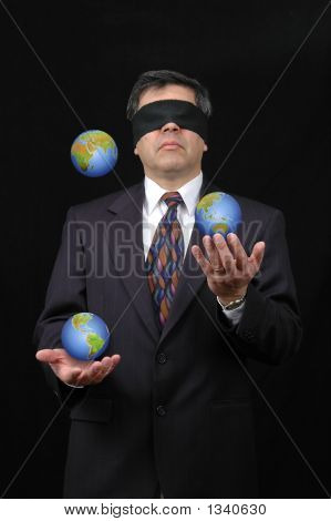 Businessman Juggling With Planet Earth