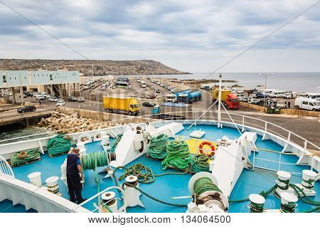 Cirkewwa Malta - May 06 2016: Ferries between the islands of Malta and Gozo transports people and cars shuttle system.