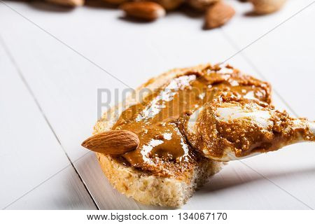 Small sandwich with homemade almond butter and nut.