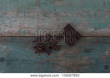 Dark chocolate on old vintage table stock photo