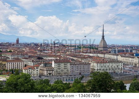 Cityscape Of Torino (turin, Italy) With The Mole Antonelliana And The Hot-air Baloon Towering Over T