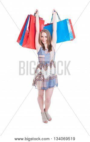 Happy Young Woman Enjoying Shopping And Rising Up Shopping Bags